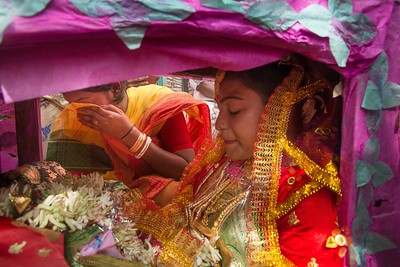 Teary eyed Priyanka goes aboard in a palanquin.