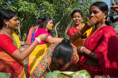 Relatives are applying turmeric after the Gaye Holud/Turmeric ceremony begins