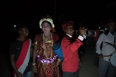 As the Hiranmay's procession headed towards the venue, followed by folk artist Nityananda Sarkar and his band. Unlike urban weddings, the parade is a low key affair. Nityananda dressed up like a Naachni. Nachni is the remaining rump of the once dominant tawaif (nautch-girl) culture.