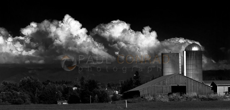 © Paul Conrad/Pablo Conrad Photography<br /> <br /> The cloud ensconced northern Cascade Range create a backdrop for a barn near the intersection of Aldrich and Smith Roads north of Belligham, Wash.