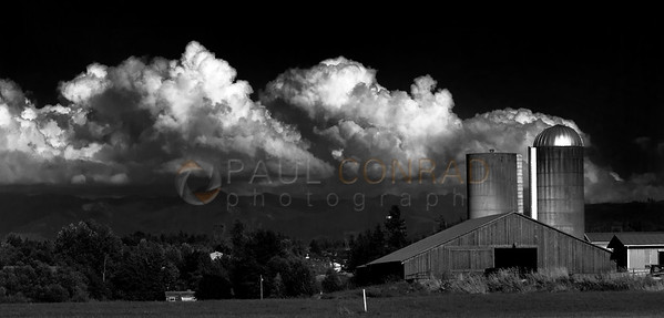 © Paul Conrad/Pablo Conrad Photography  The cloud ensconced northern Cascade Range create a backdrop for a barn near the intersection of Aldrich and Smith Roads north of Belligham, Wash.