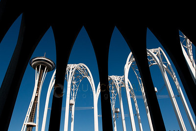 © Paul Conrad/Pablo Conrad Photography  The Space Needle as seen through the arches of the Pacific Science Center in Seattle, Wash.