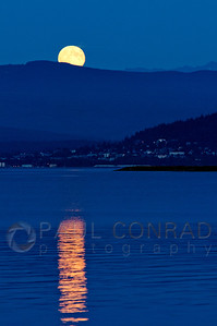 © Paul Conrad/Pablo Conrad Photography  The Moon rises near Mt. Baker east of Bellingham, Wash., on Sunday September 30, 2012, as seen from the Lummi Reservation on Lummi Shore Drive.
