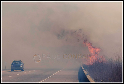 © Paul Conrad/Pablo Conrad Photography  Despite the erupting flames, drivers continue on into heavy smoke.