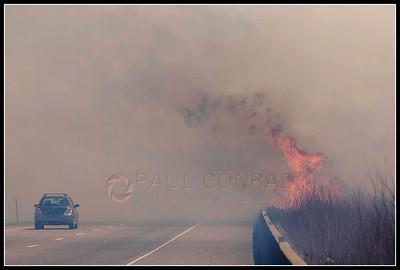 © Paul Conrad/Pablo Conrad Photography  Despite the erupting flames, drivers continue on into heavy smoke.