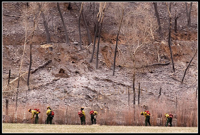 © Paul Conrad/Pablo Conrad Photography  Fire fighters clean hot spots just north of Highway 82 near Catherine Store.
