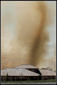© Paul Conrad/Pablo Conrad Photography  A smoke tornado rises over the Aspen Equestrian Estates. Large fires are know to create their own weather due to the intense heat they create.