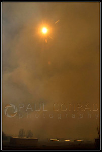 © Paul Conrad/Pablo Conrad Photography  Heavy smoke fills the sky and nearly blocks out the sun.
