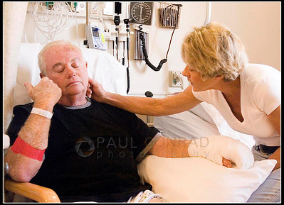 © Paul Conrad/Pablo Conrad Photography  Larry Garfinkel, 61, of Thousand Oaks, Calif, is comforted by his wife of 26 years, Angie, as he recounts his survival during the County Road 100 wildfire at Valley View Hospital in Glenwood Springs, Colo. Garfinkel was fishing the Roaring Fork River near the Ranch at Roaring Fork housing complex with friends Tom Greenup and  Chuck Hyatt when the flames of the fire overtook him and was burned while escaping. Garfinkel received third-degree burns on his left arm and back of his head. Doctors took a skin graft from his left thigh to fix his left hand and forearm.
