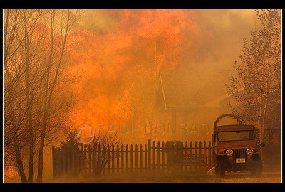 © Paul Conrad/Pablo Conrad Photography  Fire encroaches on a home in the Ranch at Roaring Fork subdivision in Carbondale, Colo.