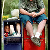 © Paul Conrad/Pablo Conrad Photography -<br /> Gina O'Leary and her brother Robert hang out at the newspaper stand while they wait for their mother to pick them up in front of Aspen Valley Hospital in Aspen, Colo.