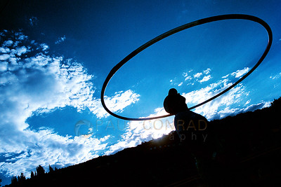 © Paul Conrad/Pablo Conrad Photography - With the sun setting behind Buttermilk Mountain near Aspen, Colo., hula hooper Dave Valentine of Telluride takes time to practice his hula hooping.