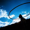 © Paul Conrad/Pablo Conrad Photography -<br /> With the sun setting behind Buttermilk Mountain near Aspen, Colo., hula hooper Dave Valentine of Telluride takes time to practice his hula hooping.