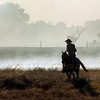 © Paul Conrad/Pablo Conrad Photography -<br /> Ryan Edigar rides through what remains of one his father's fields after a fire burned the area between Wheatridge and Omo Roads and north of Willow, Okla.
