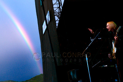 © Paul Conrad/Pablo Conrad Photography - With a sliver of a rainbow after a passing storm, Tom Petty and the Heartbreakers take the stage to play to a thunderous crowd at the Janus Jazz Aspen Labor Day festival in Snowmass Village, Colo.