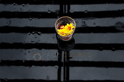 © Paul Conrad/Pablo Conrad Photography - Raindrops drip around a table setting at an Aspen, Colo., restaurant.