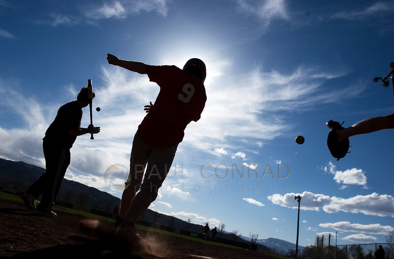 Practice Makes Perfect - The Aspen High School Skiers baseball team practices at the El Jebel, Colo., baseball diamonds in preparation for their upcoming season. Due to heavy snows that remain on their diamonds, the Skiers head downvalley to practice on the dry fields. (© Paul Conrad/Paul Conrad Photography)