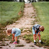 © Paul Conrad/Pablo Conrad Photography - Two kids play in the driveway leading to their Bowling Green, Ky., home.