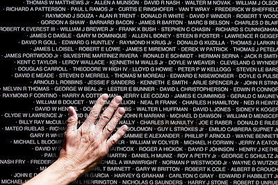 © Paul Conrad/Pablo Conrad Photography -  A visitor's hand reaches to touch the engraved names of those service men and women killed in the Vietnam War after the moving Vietnam War Memorial stopped in Aspen, Colo.