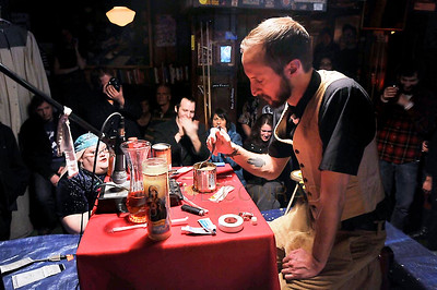 The Rev. Darnell Jenkins prepares his concoction of a mishmash of this and that during the Midnight Mass of the 7th annual Christmas Pageant and Midnight Mass at the Blue Moon Tavern on Friday night Christmas eve December 24, 2010, in Seattle, Wa.