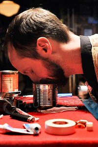 The Rev. Darnell Jenkins smells his mishmash concoction to see if it has been prepared properly during the Midnight Mass of the 7th annual Christmas Pageant and Midnight Mass at the Blue Moon Tavern on Friday night Christmas eve December 24, 2010, in Seattle, Wa.