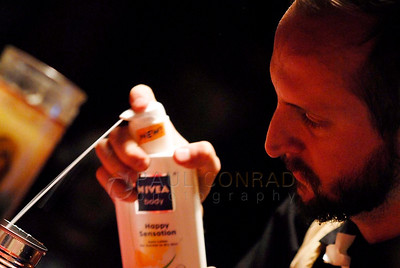 The Rev. Darnell Jenkins adds hand cream to his mishmash concoction during the Midnight Mass of the 7th annual Christmas Pageant and Midnight Mass at the Blue Moon Tavern on Friday night Christmas eve December 24, 2010, in Seattle, Wa.