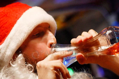 The Rev. Darnell Jenkins drinks the last of his Four Loko during the Midnight Mass of the 7th annual Christmas Pageant and Midnight Mass at the Blue Moon Tavern on Friday night Christmas eve December 24, 2010, in Seattle, Wa.