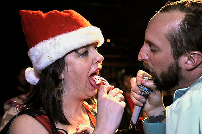 "The Rev. Darnell Jenkins, right, and an ""admirer"" exchange insults during the Midnight Mass of the 7th annual Christmas Pageant and Midnight Mass at the Blue Moon Tavern on Friday night Christmas eve December 24, 2010, in Seattle, Wa."