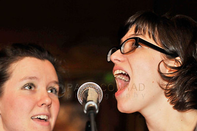 The Donner Vixens singers Kenna Chapman, left, and Kate Chapman entertain the crowd during the 7th annual Christmas Pageant and Midnight Mass at the Blue Moon Tavern on Friday night Christmas eve December 24, 2010, in Seattle, Wa.