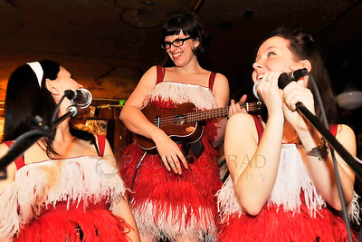 The Donner Vixens singers Stephanie Wallace, left, Kate Chapman, and Kenna Kettrick finish the bands performance during the 7th annual Christmas Pageant and Midnight Mass the Blue Moon Tavern on Friday night Christmas eve December 24, 2010, in Seattle, Wa.