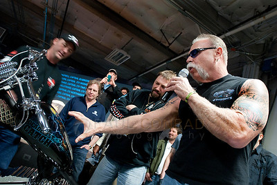 © Paul Conrad/Pablo Conrad Photography  Paul Teutul, Sr., with American Chopper describes the airbrushed crabs on a custom made bike to the Deadliest Catch captains duruing Catchcon at the Bell Harbor Conference Center on Saturday April 9, 2011, in Seattle, Wash.