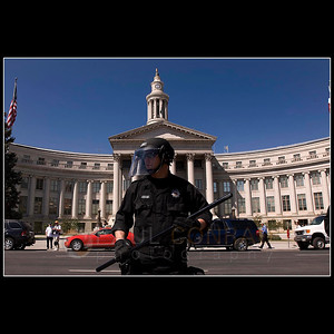 © 2008 Paul Conrad/Pablo Conrad Photography  A Denver police officer keeps a watchful on the gathering crowd of demonstrators in front of the Denver City and County Building. An initial arrest of one protestors created a volatile situation between police and the demonstrators which lead to another arrest before the police broke ranks and dispersed.