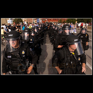 © 2008 Paul Conrad/Pablo Conrad Photography  A platoon of Denver, Colo., police wait in formation for the arrival of over 2000 anti-war demonstrators Wednesday evening Aug. 27, 2008, outside the entrance to the Pepsi Center on Speer Boulevard during the 2008 Democratic National Convention in Denver.