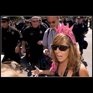 © 2008 Paul Conrad/Pablo Conrad Photography  Code Pink member Alicia Forrest talks with reporters moments before being grabbed by a member of the Denver Police, second from left, Monday morning Aug. 26, 2008, at Civic Center Park in downtown Denver, Colo.