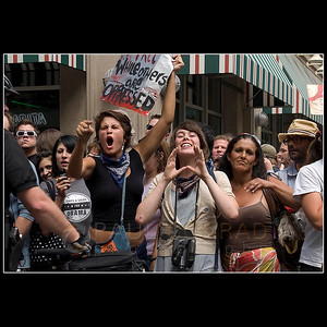 © 2008 Paul Conrad/Pablo Conrad Photography  Protestors yell across the 16th Street Mall on Monday afternoon Aug. 25, 2008, at pro-christian activists in Denver, Colo. Several arrests were made after some of the protestors became combative with the police.