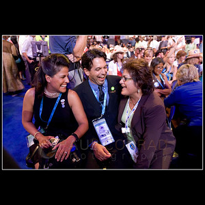 © 2008 Paul Conrad/Pablo Conrad Photography  Colorado delegates Blanca O'Leary of Aspen, left, and Brian Gonzales of Basalt chat with California delegate Maria Alegria of Piinole, Calif., on Monday afternoon Aug. 25, 2008, while schmoozing at the Pepsi Center during the Democratic National Convention in Denver.