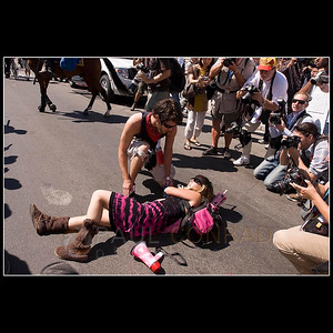 © 2008 Paul Conrad/Pablo Conrad Photography  Code Pink demonstrator Alicia Forrest gets help from a fellow demonstrator after being knocked to the groud by a Denver police officer with a baton on Tuesday morning Aug. 26, 2008, at Civic Center Park in downtown Denver, Colo.