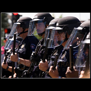 © 2008 Paul Conrad/Pablo Conrad Photography  Anti-riot police form a defensive line against a growing crowd of aggressive demonstrators Monday morning Aug. 26, 2008, in Civic Center Park in downtown Denver, Colo.