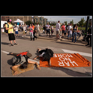 © 2008 Paul Conrad/Pablo Conrad Photography  Protestors lie in the street as hundreds walk towards the Pepsi Center in Denver, Colo., during the 2008 Democratic National Convention.