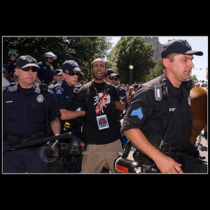 © 2008 Paul Conrad/Pablo Conrad Photography  A demonstrator screams to the media after being detained Tuesday morning Aug. 26, 2008, at Civic Center Park in downtown Denver, Colo.