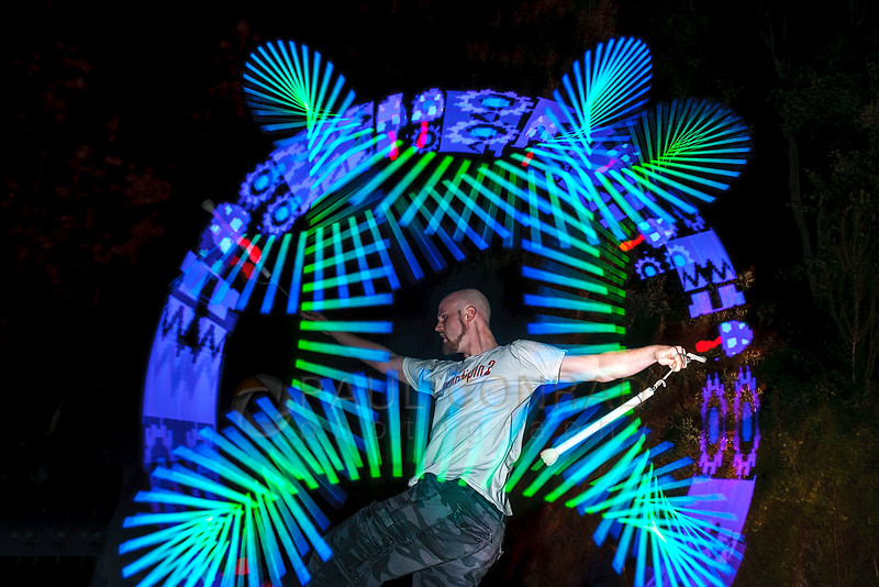 Dan Stuen uses LEDs while performing during sunset at Locust Beach on Sunday evening July 17, 2016, in Bellingham, Wash. . (© Paul Conrad/Paul Conrad Photography)