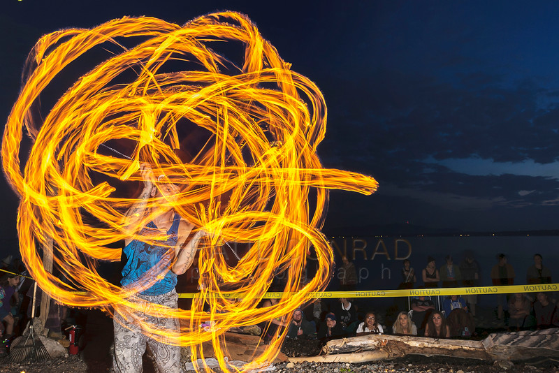 Fire performer Matt Coble of Seattle amazes over 200 people during an artists gathering at Locust Beach on Sunday evening July 17, 2016, in Bellingham, Wash.