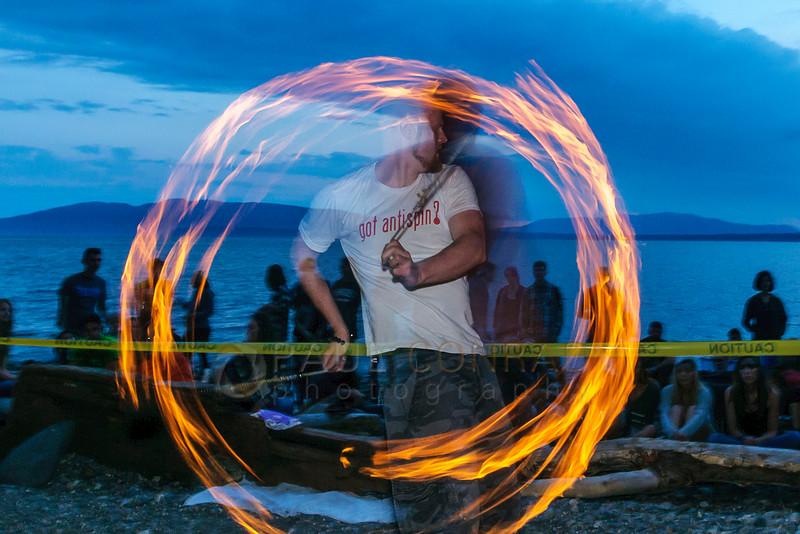 Dan Stuen begins his performance during sunset at Locust Beach. (© Paul Conrad/Paul Conrad Photography)