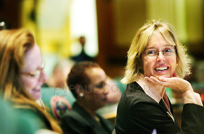 © Paul Conrad/Pablo Conrad Photography - A smiling Rep. Kathleen Curry jokes with District 36 (Arapahoe County) Rep. Morgan Carroll  before a session of the House of Representatives begins at the Colorado State Capitol building.
