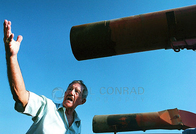 © Paul Conrad/Pablo Conrad Photography - An auctioneer in Bowling Green, Ky., selling items from a Warren County farm.