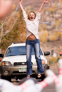 © Paul Conrad/Pablo Conrad Photography - Laurie Moore of Aspen, Colo., cheers her strike while street bowling in front of Bentley's on Mill Street in Aspen while celebrating her birthday with friends.