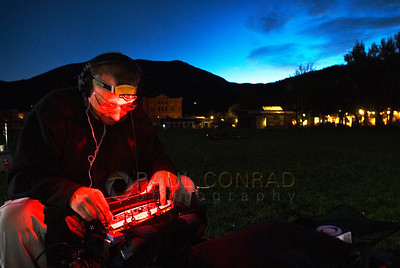 © Paul Conrad/Pablo Conrad Photography - Sound engineer Dan Johnson of Littleton monitors the microphones during a live broadcast of the CBS Early Show at Wagner Park. Over 100 locals turned up to be live on air.