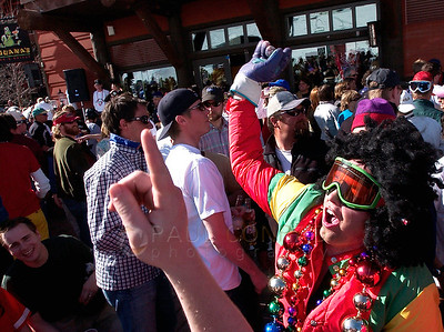 "© Paul Conrad/Pablo Conrad Photography - Jamming to the music, ""E-Dawg,"" of Aspen, Colo., dances to a DJ at Iguana's during the Aspen Highlands ski area closing party. Hundreds crowded the deck after finishing the last day of skiing at the local's favorite mountain."