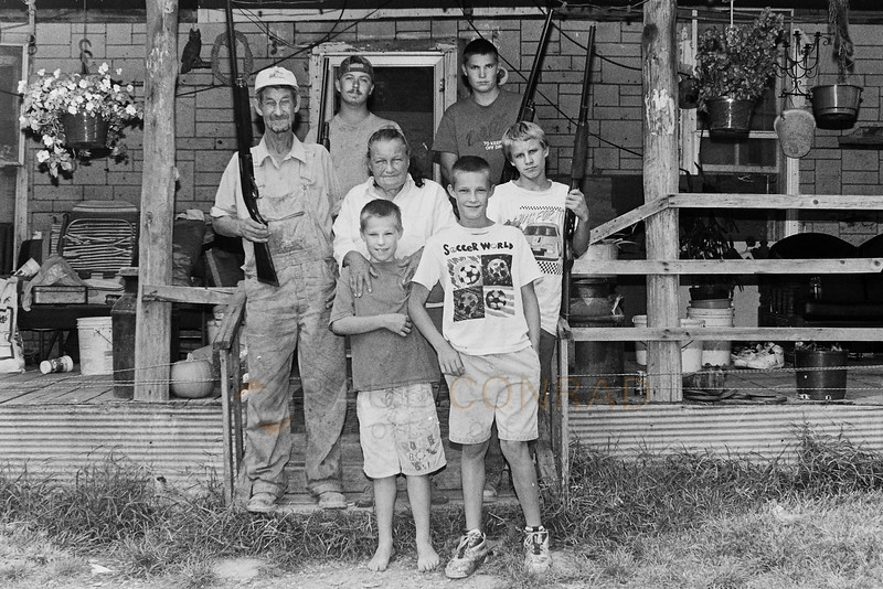 Welcome to Kentucky - The Cardwells during a hot October 1996 afternoon at their Ridge Road home in Warren County northeast of Bowling Green, Ky. The Cardwells are tenant farmers living with 8 other family members in a patched-together, 120 year old home on Ridge Road. The family makes less than $7,500 per year. (© Paul Conrad/Paul Conrad Photography)