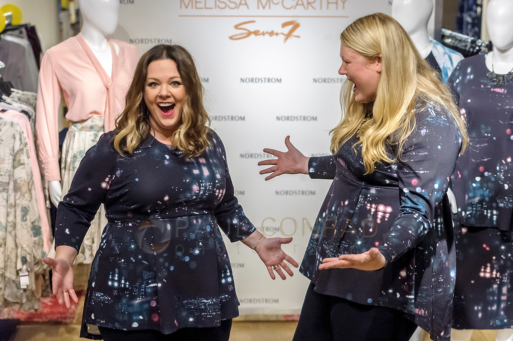 Actress Melissa McCarthy, left, has fun with a fan during a promotion for her fashion line Melissa McCarthy Seven7 at Nordstrom Downtown Seattle on July 22, 2016 in Seattle, Washington. (Photo by Paul Conrad/Getty Images for Nordstrom